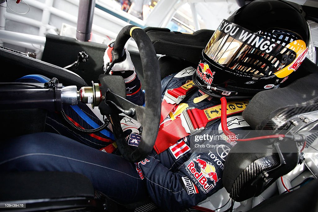Brian Vickers driver of the Red Bull Toyota sits in his car during practice for the Subway Fresh Fit 500 at Phoenix International Raceway on February...