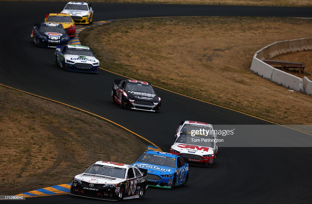 Brian Vickers, driver of the #55 RK Motors Toyota, leads a pack of cars during the NASCAR Sprint Cup Series Toyota/Save Mart 350 at Sonoma Raceway on June 23, 2013 in Sonoma, California.
