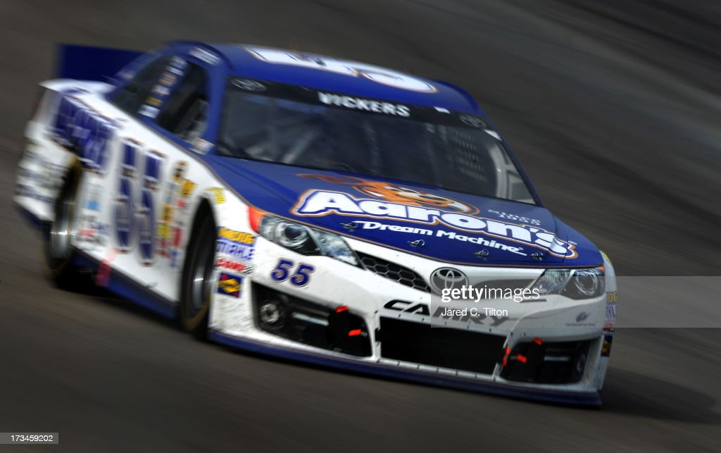 <a gi-track='captionPersonalityLinkClicked' href=/galleries/search?phrase=Brian+Vickers&family=editorial&specificpeople=171225 ng-click='$event.stopPropagation()'>Brian Vickers</a> drives the #55 Aaron's Dream Machine Toyota during the NASCAR Sprint Cup Series Camping World RV Sales 301 at New Hampshire Motor Speedway on July 14, 2013 in Loudon, New Hampshire.