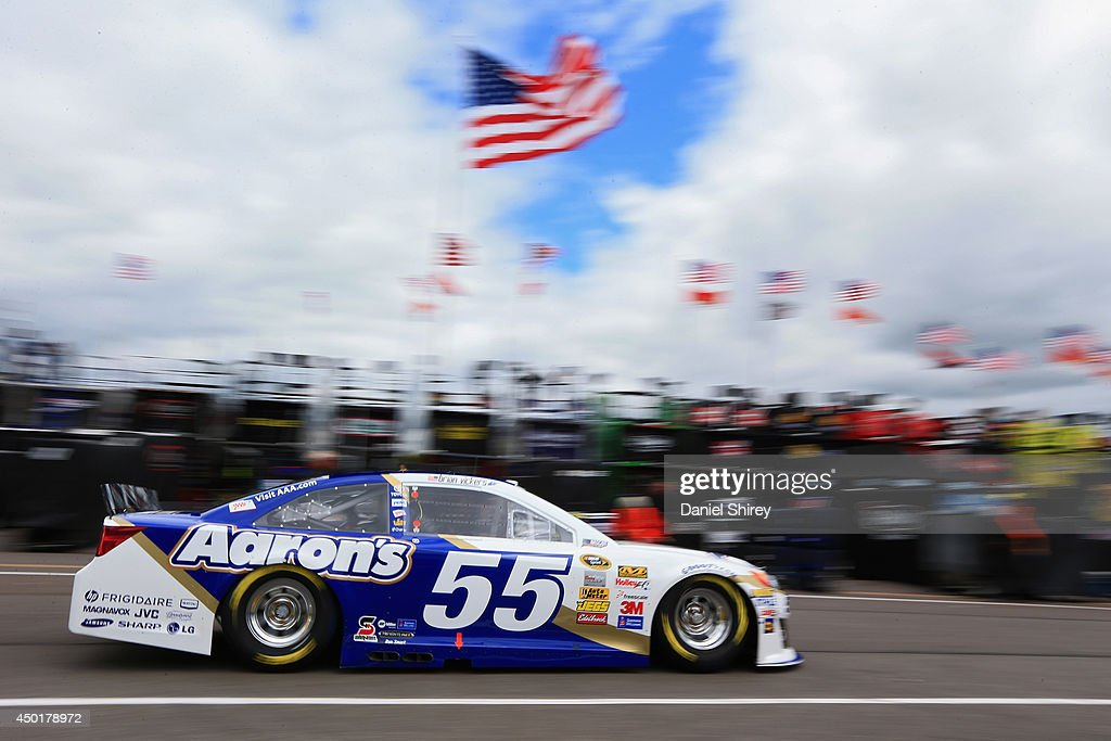 Brian Vickers drives the #55 Aaron's Dream Machine Toyota through the garage area during practice for the NASCAR Sprint Cup Series Pocono 400 at Pocono Raceway on June 6, 2014 in Long Pond, Pennsylvania.