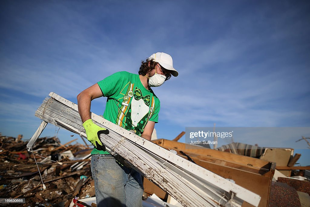 Brian Vitsmun removes debris from his home that was destroyed by a tornado on June 2, 2013 in Moore, Oklahoma. Residents of Moore, Oklahoma continue to recover and sift through the remains of their homes two weeks after a devastating EF-5 tornado ripped through the town killing 24 people and destroying hundreds of homes and businesses.