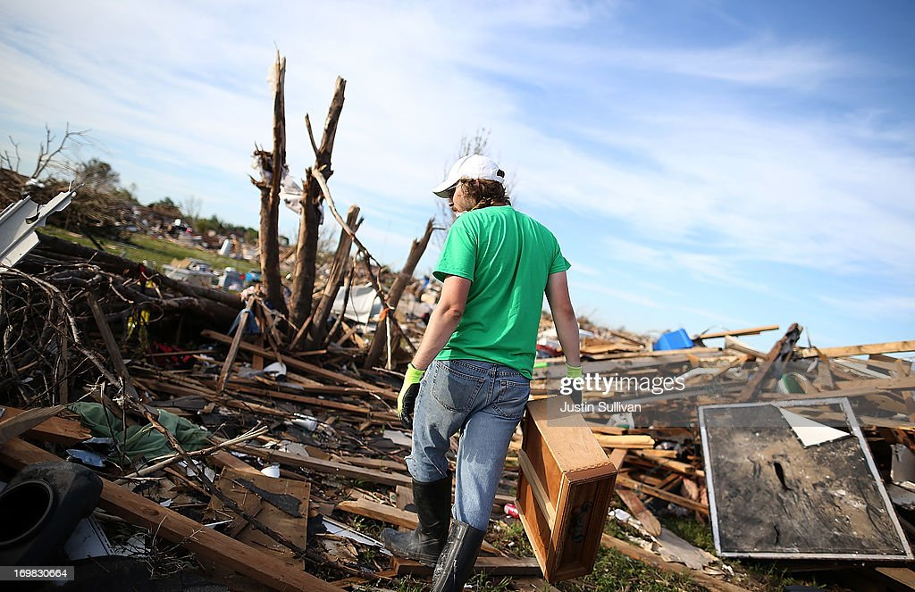 Brian Vitsmun sorts through debris at his home that was destroyed by a tornado on June 2, 2013 in Moore, Oklahoma. Residents of Moore, Oklahoma continue to recover and sift through the remains of their homes two weeks after a devastating EF-5 tornado ripped through the town killing 24 people and destroying hundreds of homes and businesses.