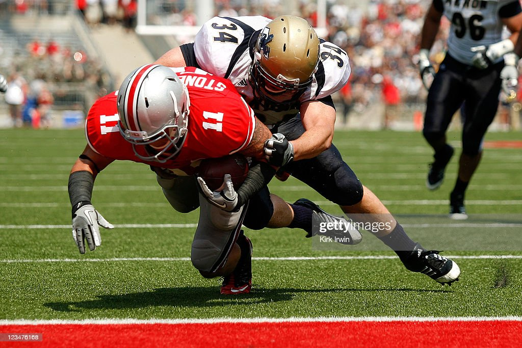 Brian Wagner #34 of the Akron Zips is unable to stop Jake Stoneburner #11 of the Ohio State Buckeyes as he dives into the end zone to score during the second quarter on September 3, 2011 at Ohio Stadium in Columbus, Ohio.