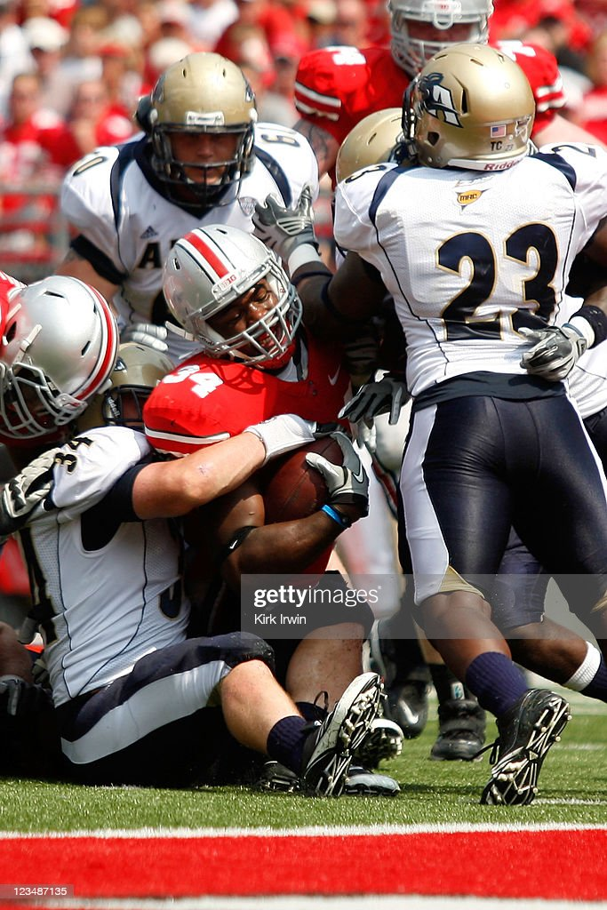 Brian Wagner #34 of the Akron Zips wraps up Nate Ebner #34 of the Ohio State Buckeyes during the third quarter on September 3, 2011 at Ohio Stadium in Columbus, Ohio. Ohio State defeated Akron 42-0.