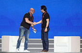 Brian Wallace CMO of Magic Leap and Dong Benhong CMO of Alibaba Group shake hands during the Taobao Maker Festival at Shanghai World Expo Exhibition...