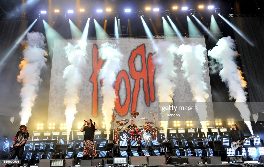 Brian Welch, Johnathan Davis, Ray Luzier and James Shaffer of Korn perform on stage during Day 2 of the Reading Festival at Richfield Avenue on August 26, 2017 in Reading, England.