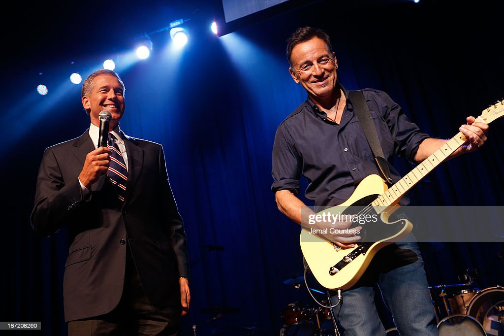 Brian Williams and Bruce Springsteen onstage at the 7th annual 'Stand Up For Heroes' event at Madison Square Garden on November 6, 2013 in New York City.