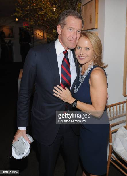 Brian Williams and Katie Couric attend the New York Giants Super Bowl Pep Rally Luncheon at Michael's on February 1 2012 in New York City