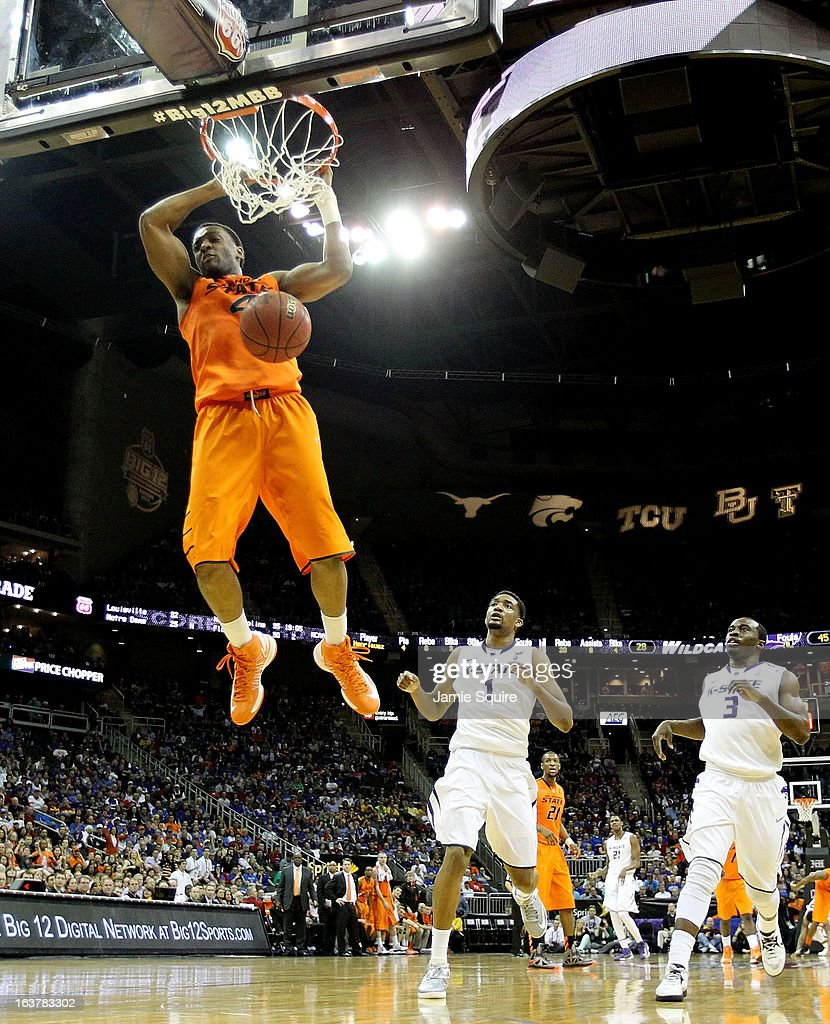 Brian Williams #4 of the Oklahoma State Cowboys dunks against Shane Southwell #1 and Martavious Irving #3 of the Kansas State Wildcats in the first half during the Semifinals of the Big 12 basketball tournament at the Sprint Center on March 15, 2013 in Kansas City, Missouri.