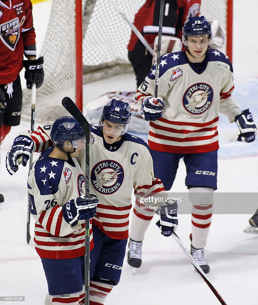 Brian Williams #26 of the Tri-City Americans celebrates his goal against the Vancouver Giants with teammates Brian McCue #16 and Michael Rasmussen #15 during the first period of their WHL game at the Pacific Coliseum on October 16, 2015 in Vancouver, British Columbia, Canada.