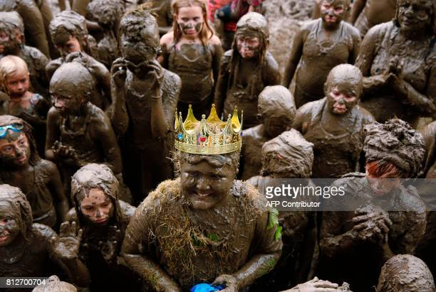 TOPSHOT Brian Wilson 10 of Redford smiles after being crowned Mud Day King at Wayne County's annual Mud Day at Nankin Mills Park on July 11 2017 in...
