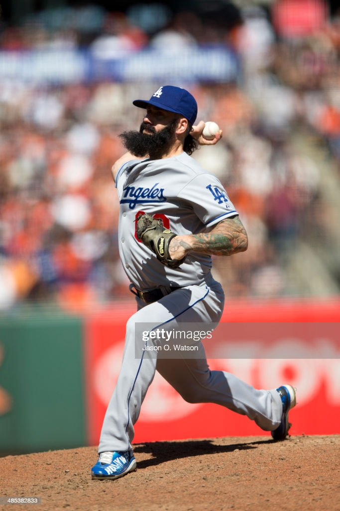 Brian Wilson #00 of the Los Angeles Dodgers pitches against the San Francisco Giants during the eighth inning at AT&T Park on April 17, 2014 in San Francisco, California.