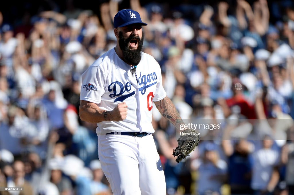 Brian Wilson #00 of the Los Angeles Dodgers reacts in the eighth inning against the St. Louis Cardinals in Game Five of the National League Championship Series at Dodger Stadium on October 16, 2013 in Los Angeles, California.