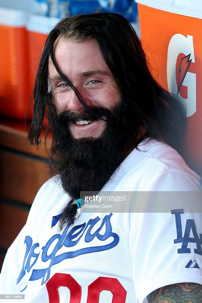 Brian Wilson #00 of the Los Angeles Dodgers sits in the dugout before the Dodgers take on the St. Louis Cardinals in Game Four of the National League Championship Series at Dodger Stadium on October 15, 2013 in Los Angeles, California.