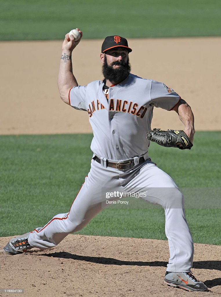 Brian Wilson #38 of the San Francisco Giants pitches during the 11th inning of a baseball game against the San Diego Padres at Petco Park on July 17, 2011 in San Diego, California.