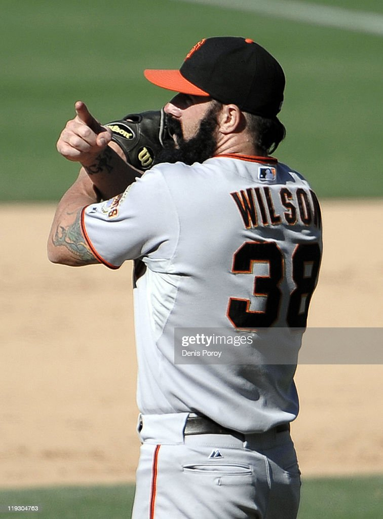 Brian Wilson #38 of the San Francisco Giants reacts after getting the final during the 11th inning of a baseball game against the San Diego Padres at Petco Park on July 17, 2011 in San Diego, California.