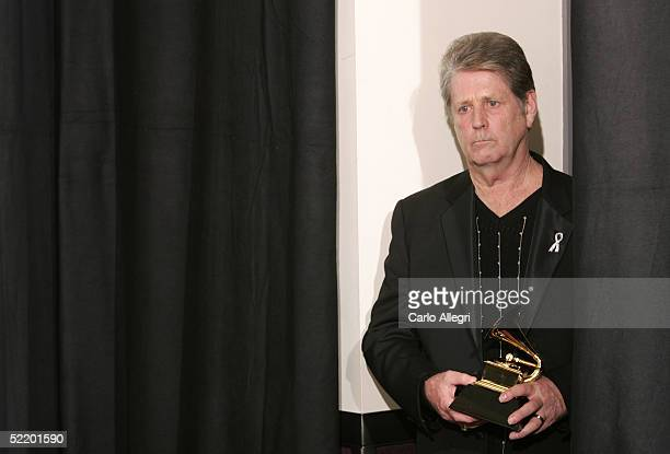 Brian Wilson pauses backstage with his award for 'Best Rock Instrumental Performance' for 'Mrs O'Leary's Cow' during the 47th Annual Grammy Awards at...