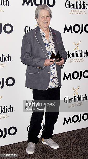 Brian Wilson poses in front of the winners boards with the MOJO Hall of Fame Award at the Glenfiddich Mojo Honours List 2011 awards ceremony at The...