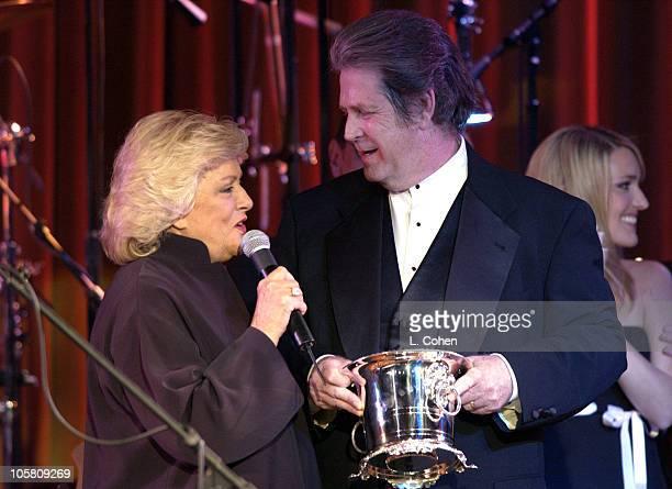 Brian Wilson recieves the BMI ICON award from Frances W Preston president/CEO of BMI
