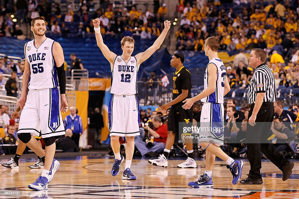 Brian Zoubek #55 and <a gi-track='captionPersonalityLinkClicked' href=/galleries/search?phrase=Kyle+Singler&family=editorial&specificpeople=4216029 ng-click='$event.stopPropagation()'>Kyle Singler</a> #12 of the Duke Blue Devils react late in the second half against the West Virginia Mountaineers during the National Semifinal game of the 2010 NCAA Division I Men's Basketball Championship at Lucas Oil Stadium on April 3, 2010 in Indianapolis, Indiana.