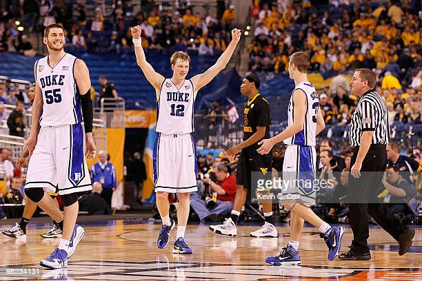 Brian Zoubek and Kyle Singler of the Duke Blue Devils react late in the second half against the West Virginia Mountaineers during the National...