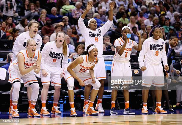 Briana Day of the Syracuse Orange and teammates cheer from the bench in the third quarter against the Washington Huskies during the semifinals of the...