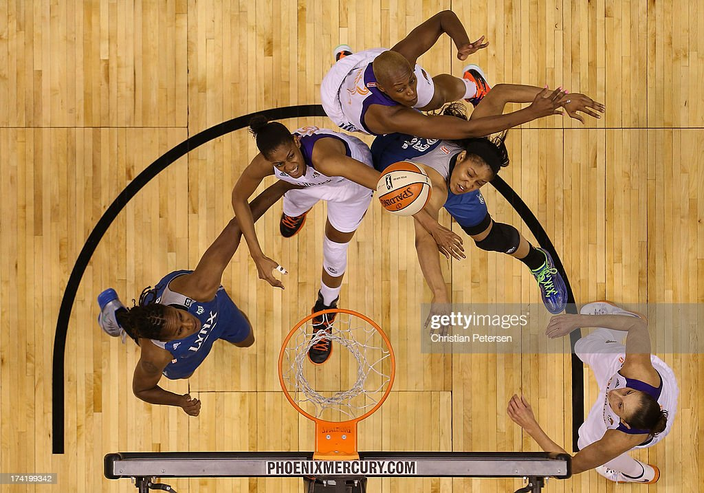 Briana Gilbreath #15 of the Phoenix Mercury and Maya Moore#23 of the Minnesota Lynx reach for a rebound during the first half of the WNBA game at US Airways Center on July 21, 2013 in Phoenix, Arizona. The Lynx defeated the Mercury 82-77.