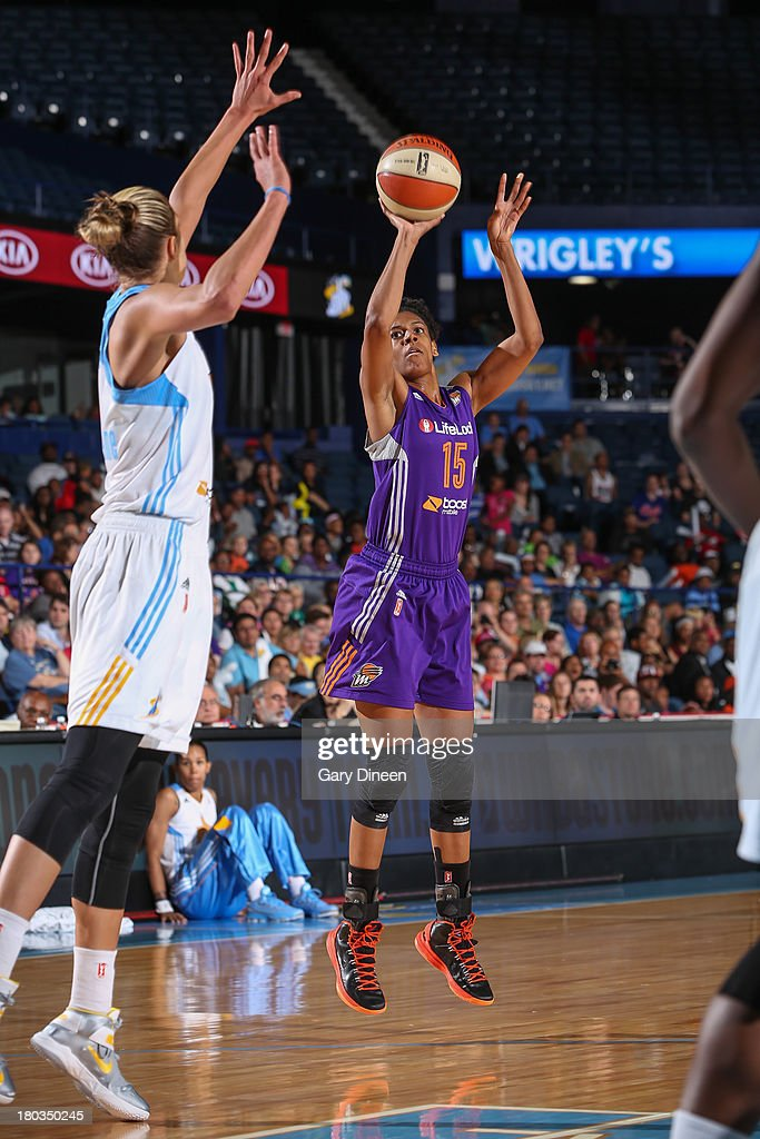 Briana Gilbreath #15 of the Phoenix Mercury shoots the ball against Elena Delle Donne #11 of the Chicago Sky during the game on September 11, 2013 at the Allstate Arena in Rosemont, Illinois.