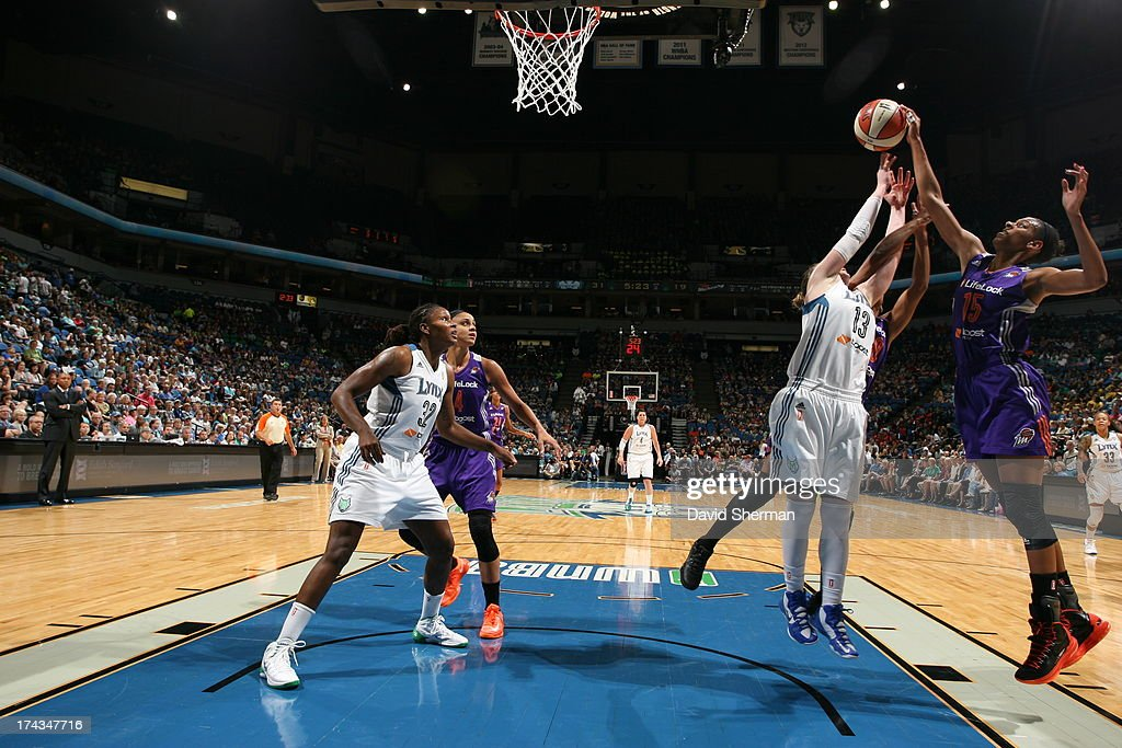 Briana Gilbreath #15 of the the Phoenix Mercury rebounds against Lindsay Whalen #13 of the Minnesota Lynx during the WNBA game on July 24, 2013 at Target Center in Minneapolis, Minnesota.