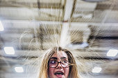 Briana Goodoak 15 and in 10th grade at Casco Bay High School touches a Van de Graaff generator demonstration at USM's Engineering Physics booth...