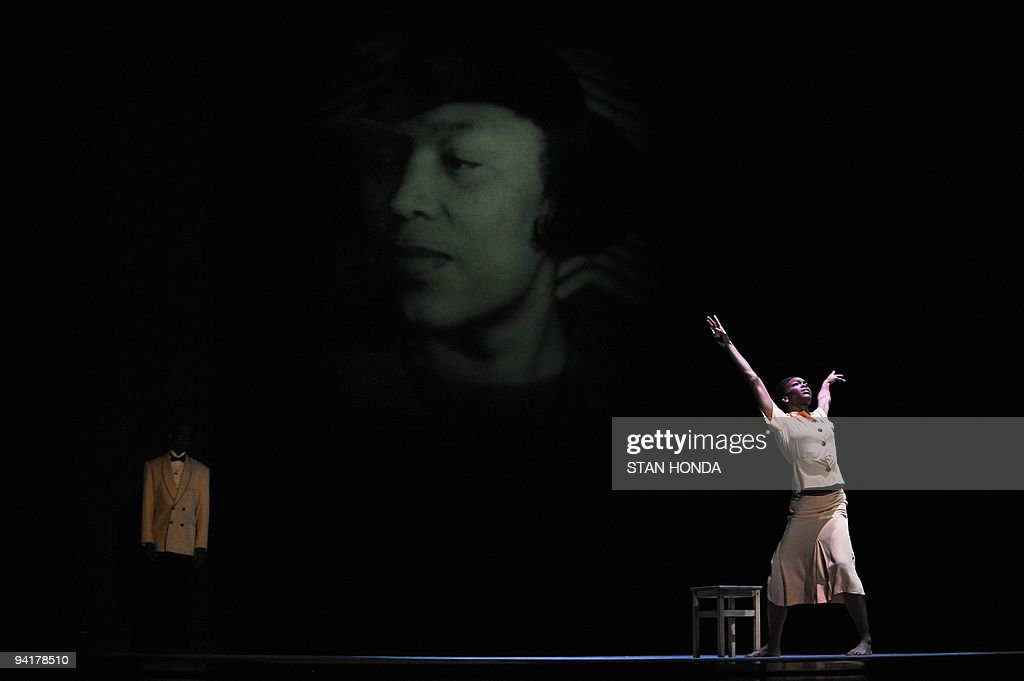 Briana Reed (R) of the Alvin Ailey American Dance Theater during dress rehearsal of 'Uptown', chorographed by Matthew Rushing, December 9, 2009 in New York. The performance highlights key events of the Harlem Renaissance era in the 1920's. A photograph of writer Zora Neale Hurston is projected on a backdrop. AFP PHOTO/Stan Honda