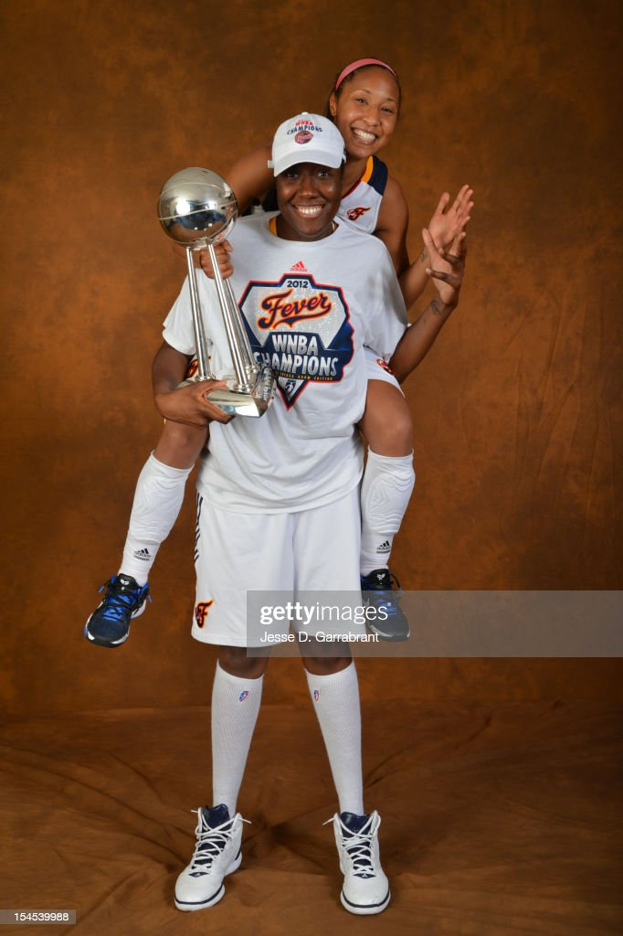 Briann January #20 and Jessica Davenport #50 of the Indiana Fever poses for portraits with the Championship Trophy after Game four of the 2012 WNBA Finals on October 21, 2012 at Bankers Life Fieldhouse in Indianapolis, Indiana.