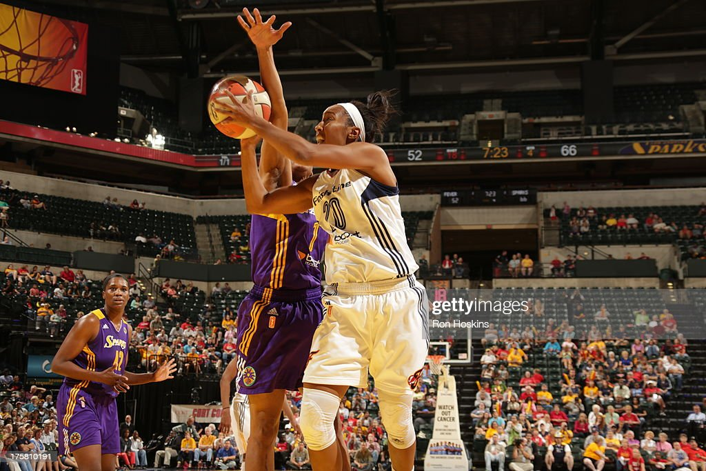 Briann January #20 of the Indiana Fever battles A'dia Mathies #1 of the Los Angeles Sparks on August 8, 2013 at Bankers Life Fieldhouse in Indianapolis, Indiana.