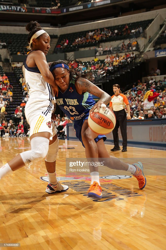 <a gi-track='captionPersonalityLinkClicked' href=/galleries/search?phrase=Briann+January&family=editorial&specificpeople=4530291 ng-click='$event.stopPropagation()'>Briann January</a> #20 of the Indiana Fever battles <a gi-track='captionPersonalityLinkClicked' href=/galleries/search?phrase=Cappie+Pondexter&family=editorial&specificpeople=544600 ng-click='$event.stopPropagation()'>Cappie Pondexter</a> #23 of the New York Liberty on July 23, 2013 at Bankers Life Fieldhouse in Indianapolis, Indiana.