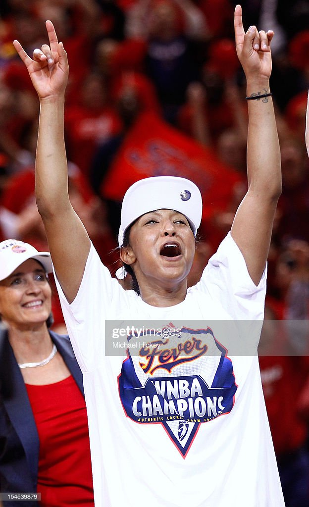 Briann January #20 of the Indiana Fever celebrates after defeating the Minnesota Lynx in Game Four of the 2012 WNBA Finals on October 21, 2012 at Bankers Life Fieldhouse in Indianapolis, Indiana.