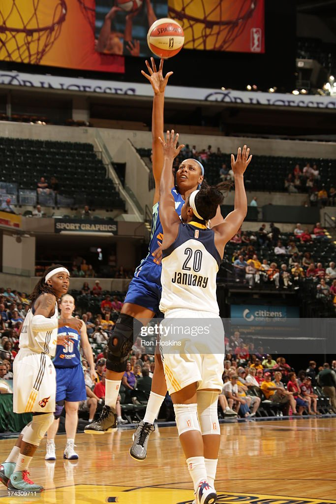 <a gi-track='captionPersonalityLinkClicked' href=/galleries/search?phrase=Briann+January&family=editorial&specificpeople=4530291 ng-click='$event.stopPropagation()'>Briann January</a> #20 of the Indiana Fever defends against Pienette Pierson #33 of the New York Liberty on July 23, 2013 at Bankers Life Fieldhouse in Indianapolis, Indiana.