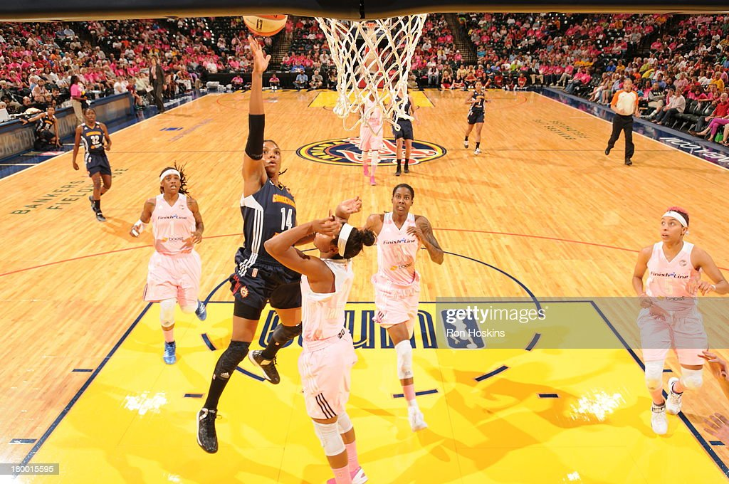 Briann January of the Indiana Fever defends Tan White of the Connecticut Sun on September 7 2013 at Bankers Life Fieldhouse in Indianapolis Indiana...