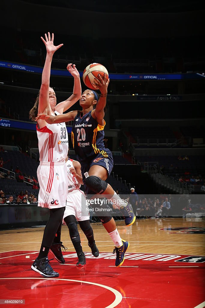 Briann January #24 of the Indiana Fever drives against Emma Meesseman #33 of the Washington Mystics in Game Two of the Eastern Conference Semifinals during the 2014 WNBA Playoffs on August 23, 2014 at the Verizon Center in Washington, DC.