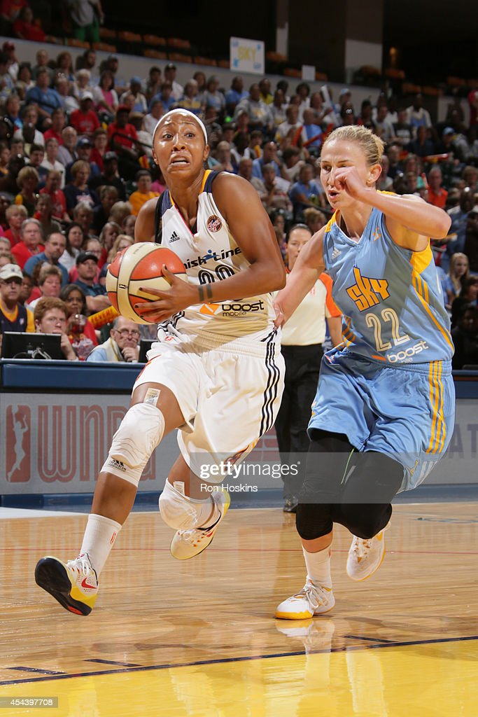 Briann January #20 of the Indiana Fever drives to the basket against Courtney Vandersloot #22 of the Chicago Sky during game one of the 2014 WNBA Eastern Conference Finals on August 30, 2014 at Bankers Life Fieldhouse in Indianapolis, Indiana.