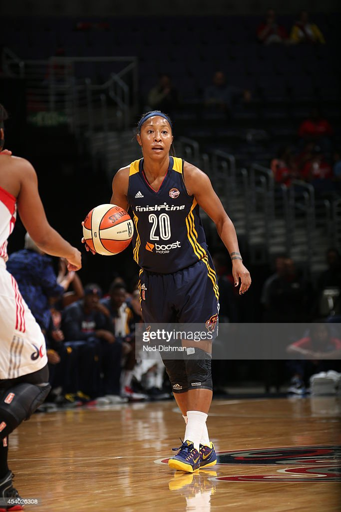Briann January #20 of the Indiana Fever handles the ball against the Washington Mystics in Game Two of the Eastern Conference Semifinals during the 2014 WNBA Playoffs on August 23, 2014 at the Verizon Center in Washington, DC.
