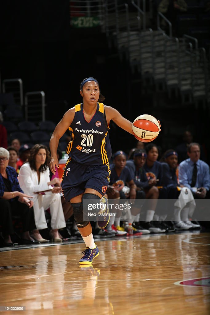<a gi-track='captionPersonalityLinkClicked' href=/galleries/search?phrase=Briann+January&family=editorial&specificpeople=4530291 ng-click='$event.stopPropagation()'>Briann January</a> #20 of the Indiana Fever handles the ball against the Washington Mystics in Game Two of the Eastern Conference Semifinals during the 2014 WNBA Playoffs on August 23, 2014 at the Verizon Center in Washington, DC.