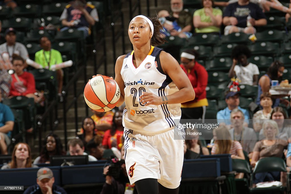 <a gi-track='captionPersonalityLinkClicked' href=/galleries/search?phrase=Briann+January&family=editorial&specificpeople=4530291 ng-click='$event.stopPropagation()'>Briann January</a> #20 of the Indiana Fever handles the ball against the Washington Mystics in a WNBA game on June 20, 2015 at Bankers Life Fieldhouse in Indianapolis, Indiana.