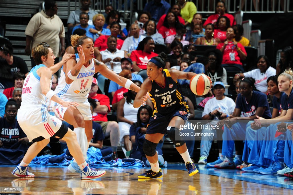 <a gi-track='captionPersonalityLinkClicked' href=/galleries/search?phrase=Briann+January&family=editorial&specificpeople=4530291 ng-click='$event.stopPropagation()'>Briann January</a> #20 of the Indiana Fever handles the ball against the Atlanta Dream on July 1, 2014 at Philips Arena in Atlanta, Georgia.