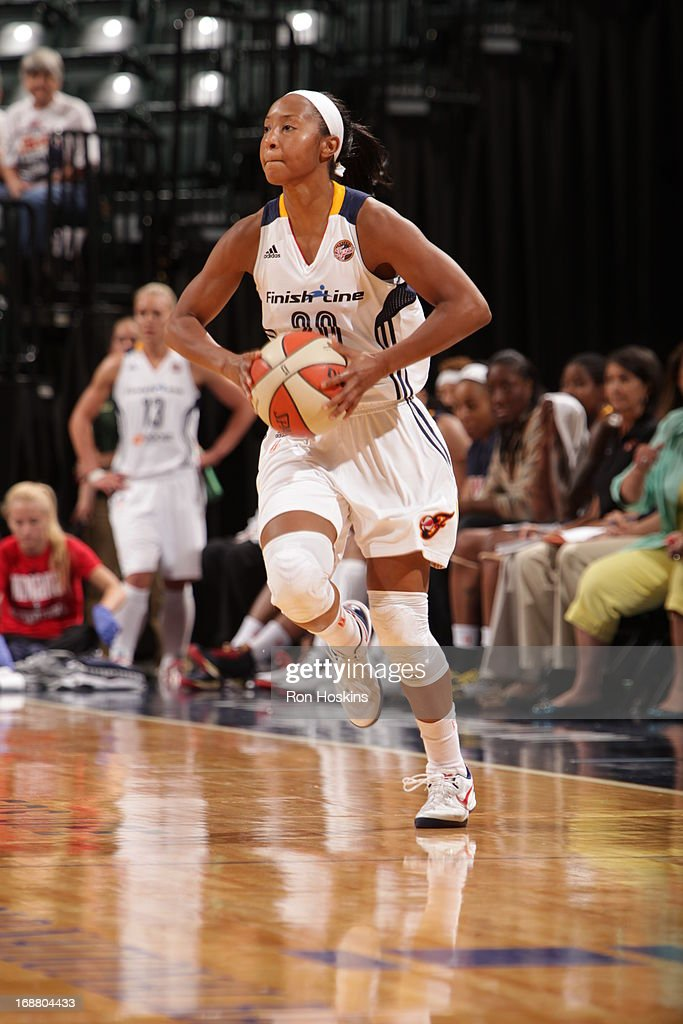 Briann January #20 of the Indiana Fever looks to make a pass against the San Antonio Silver Stars on May 13, 2013 at Bankers Life Fieldhouse in Indianapolis, Indiana.