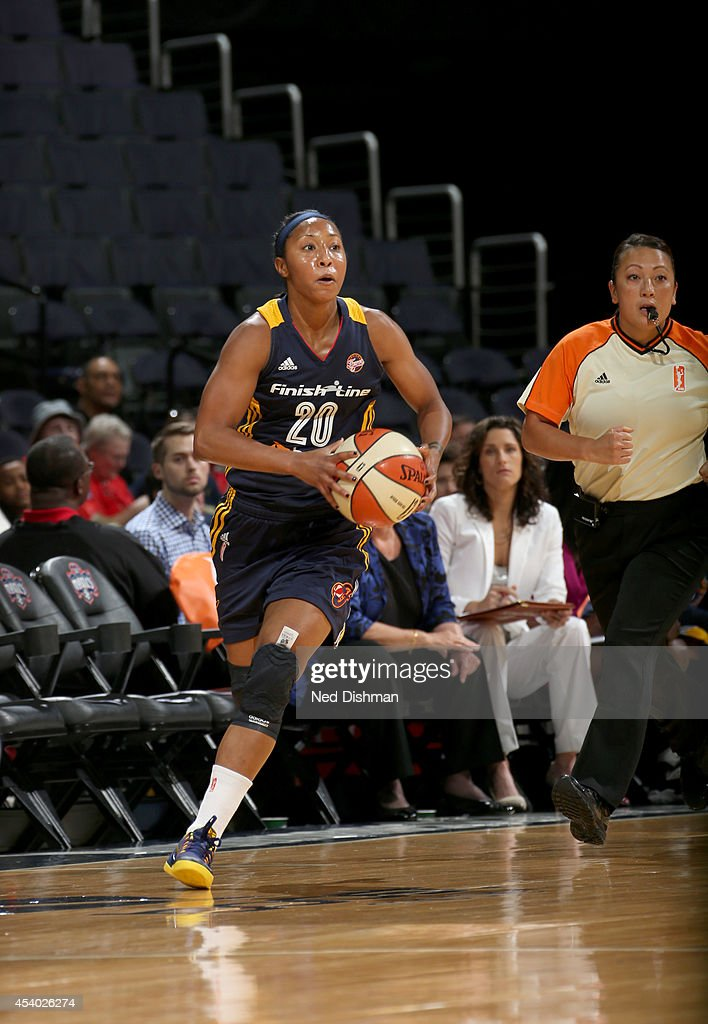 Briann January #20 of the Indiana Fever looks to pass the ball against the Washington Mystics in Game Two of the Eastern Conference Semifinals during the 2014 WNBA Playoffs on August 23, 2014 at the Verizon Center in Washington, DC.