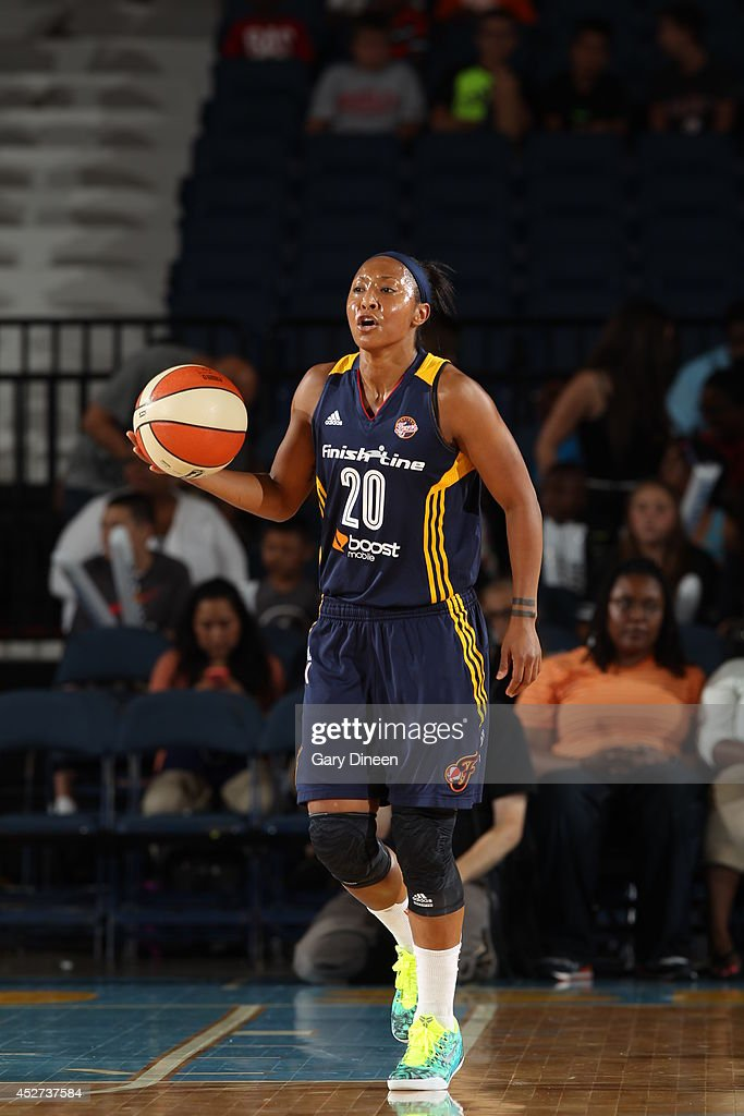 Briann January #20 of the Indiana Fever moves the ball up-court against the Chicago Sky on July 22, 2014 at the Allstate Arena in Rosemont, Illinois.