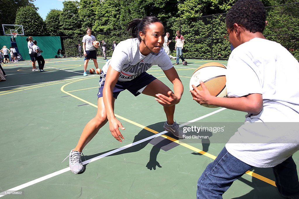 <a gi-track='captionPersonalityLinkClicked' href=/galleries/search?phrase=Briann+January&family=editorial&specificpeople=4530291 ng-click='$event.stopPropagation()'>Briann January</a> #20 of the Indiana Fever participates in a clinic on the White House basketball court during a visit to the White House to recognize the 2012 WNBA Champions on June 14, 2013 in Washington, DC.