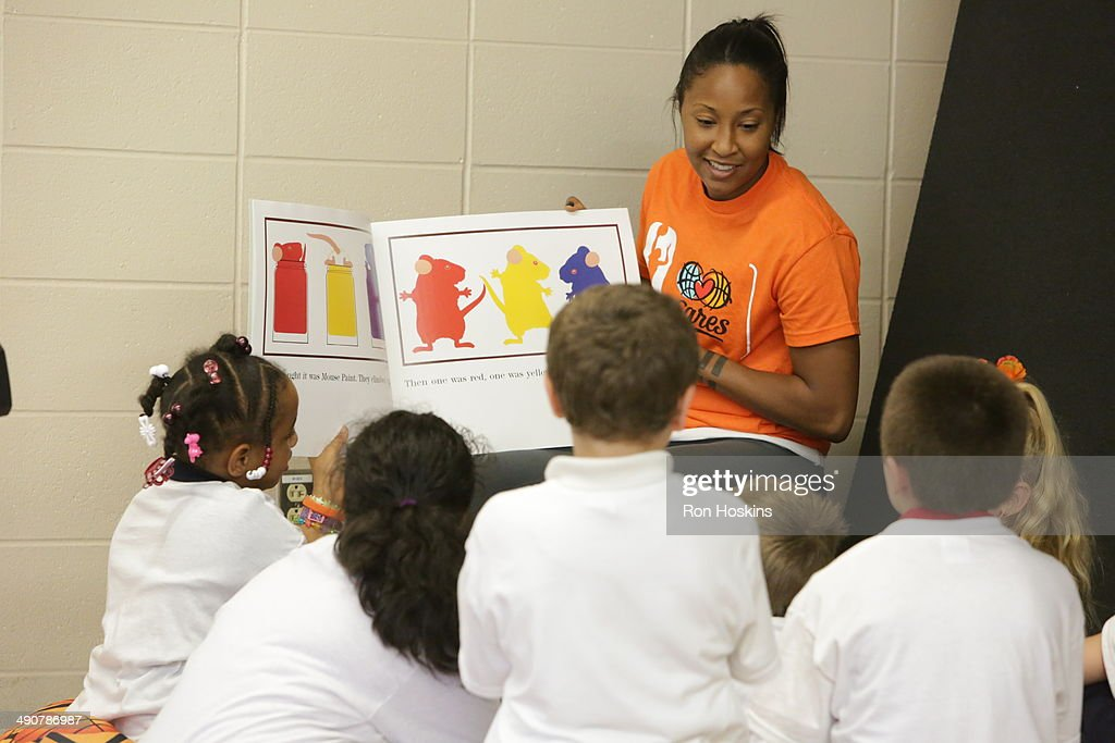 <a gi-track='captionPersonalityLinkClicked' href=/galleries/search?phrase=Briann+January&family=editorial&specificpeople=4530291 ng-click='$event.stopPropagation()'>Briann January</a> #20 of the Indiana Fever participates in the Indiana Fevers 2014 Fever Cares Tipoff Event, in partnership with the Indy Parks Foundation and Indy Parks on May 14, 2014 at Garfield Park in Indianapolis, Indiana.