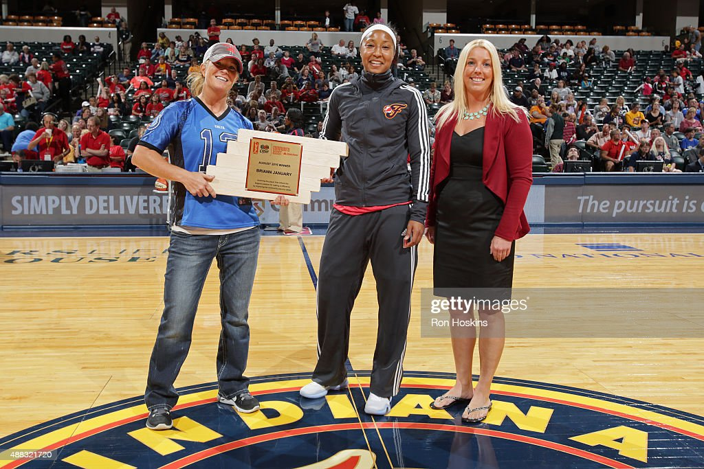 <a gi-track='captionPersonalityLinkClicked' href=/galleries/search?phrase=Briann+January&family=editorial&specificpeople=4530291 ng-click='$event.stopPropagation()'>Briann January</a> #20 of the Indiana Fever poses for a photo with her community assist award before the game against the New York Liberty at Bankers Life Fieldhouse on September 13, 2015 in Indianapolis, Indiana.