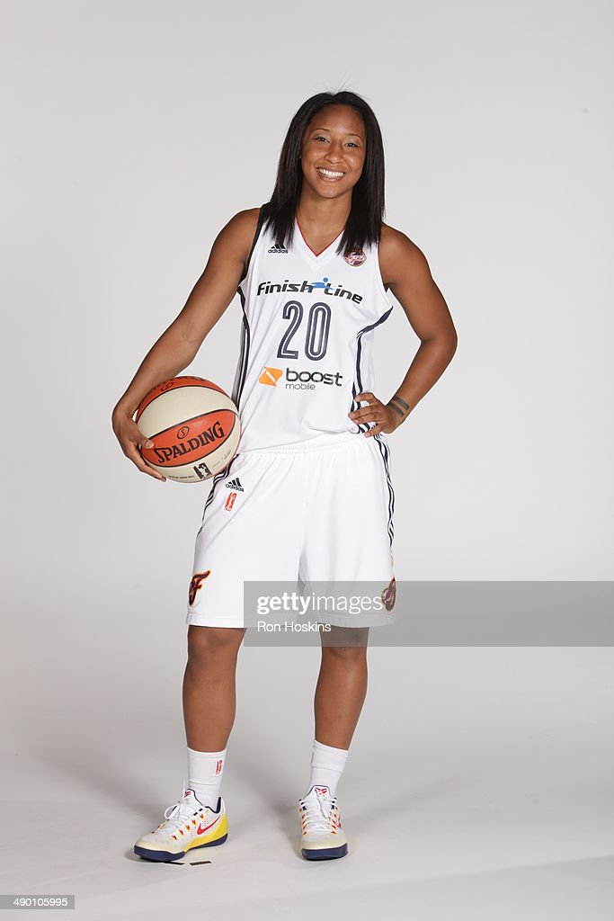 <a gi-track='captionPersonalityLinkClicked' href=/galleries/search?phrase=Briann+January&family=editorial&specificpeople=4530291 ng-click='$event.stopPropagation()'>Briann January</a> #20 of the Indiana Fever poses for a portrait during 2014 WNBA Media Day at Bankers Life Fieldhouse on May 12, 2014 in Indianapolis, Indiana.